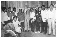 "President Virgilio Barco with Indian leaders during the ceremony where the ""Predio Putumayo"" was handed over to the Indian communities. In the photograph, from left to right: Alejandro Teteye, Fisi Andoque, Dagoberto Castro, Isaak Makuna, President Virgilio Barco, Reynaldo Giagrecudo, Luis Guerrero, Eduardo Paki, Alfonso Pinedo. Seated: Wilson Sokaigredo, Ignacio Atama. Photo: Fabio Trujillo."